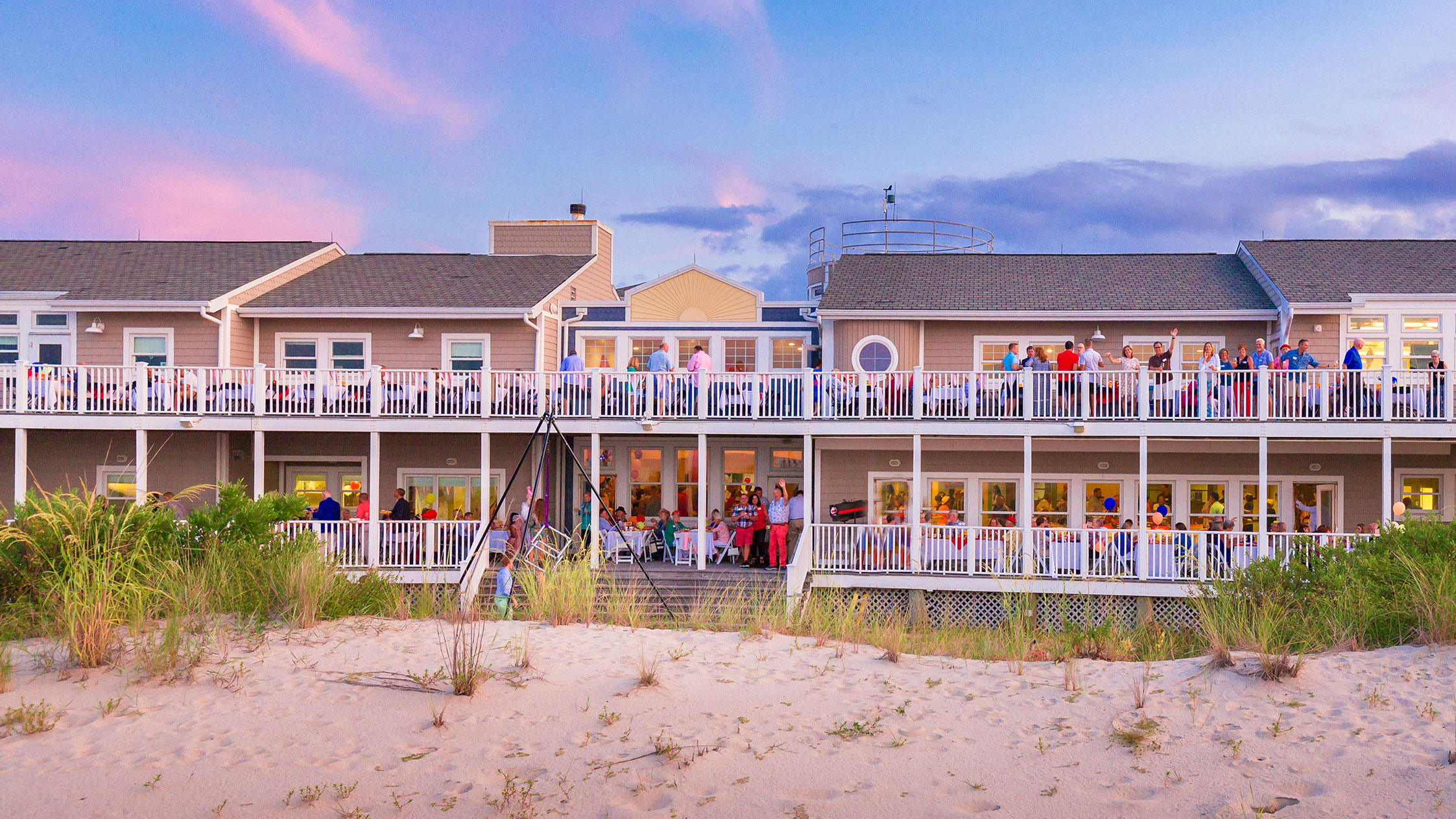 Beach special events venue with people on the back decks.