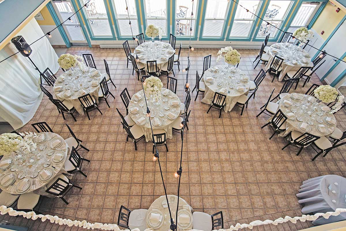 Beach wedding venue dining room from above.