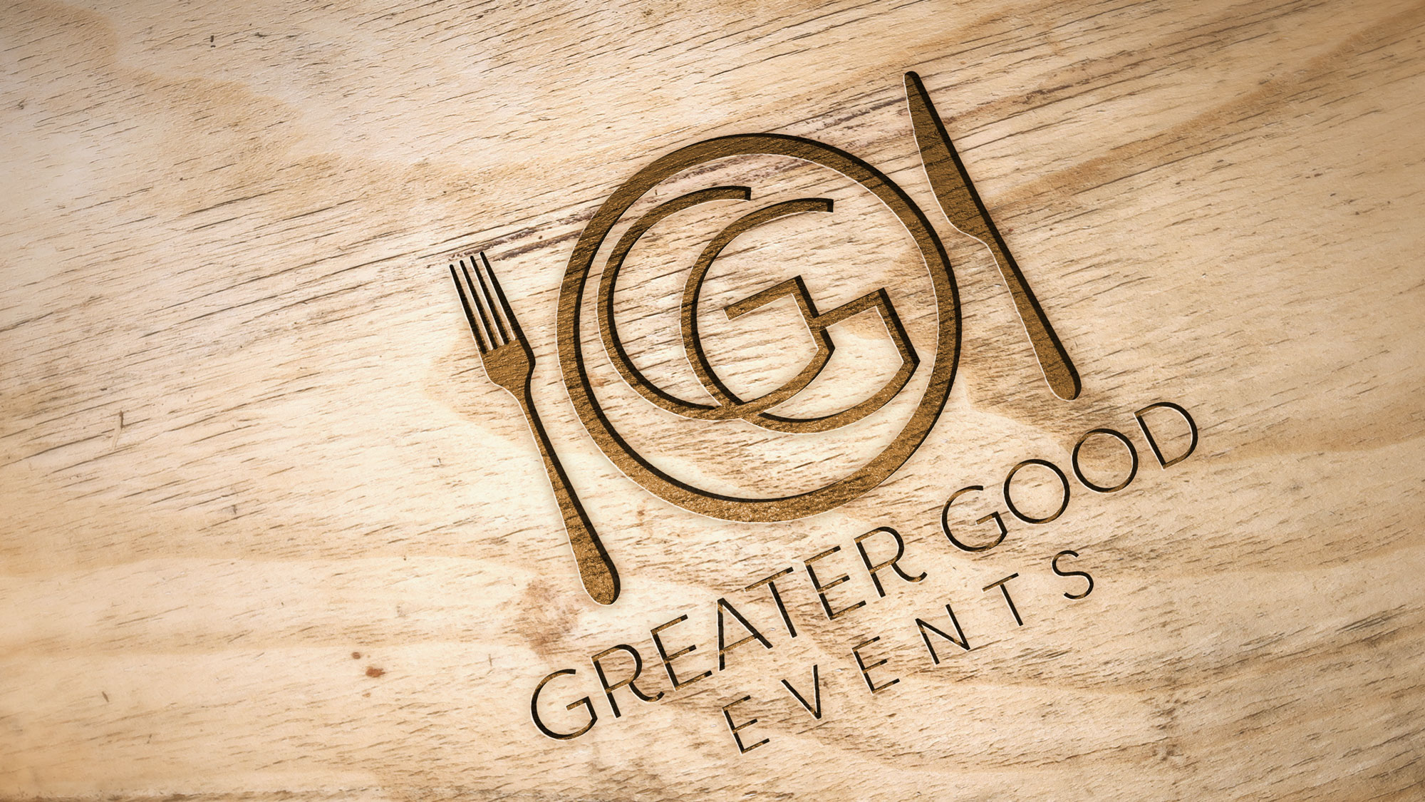 Greater Good Events logo engraved in wood.