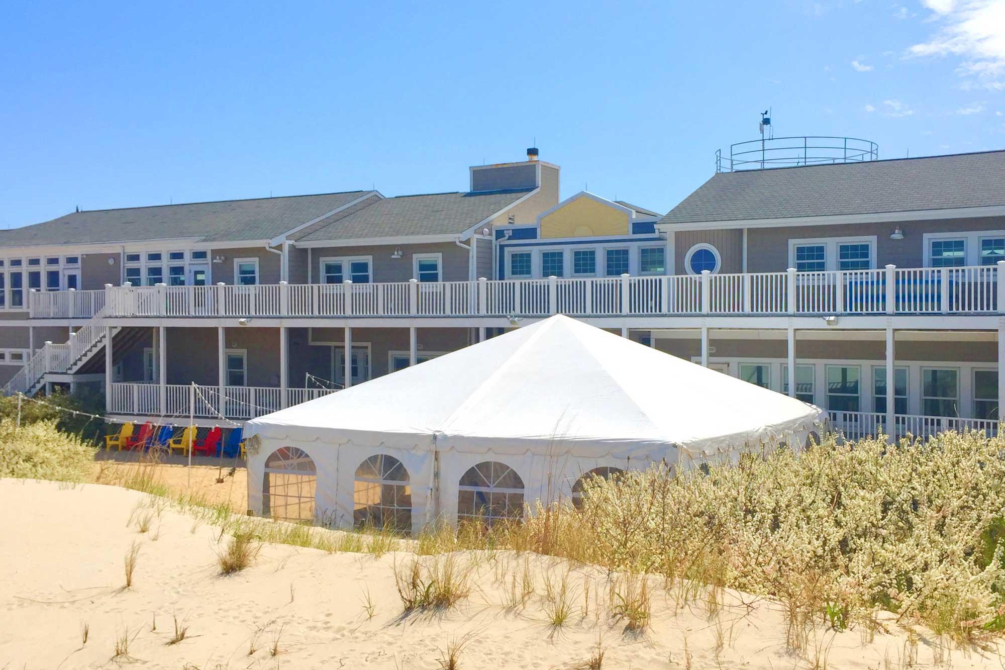 Beach wedding venue with tent.