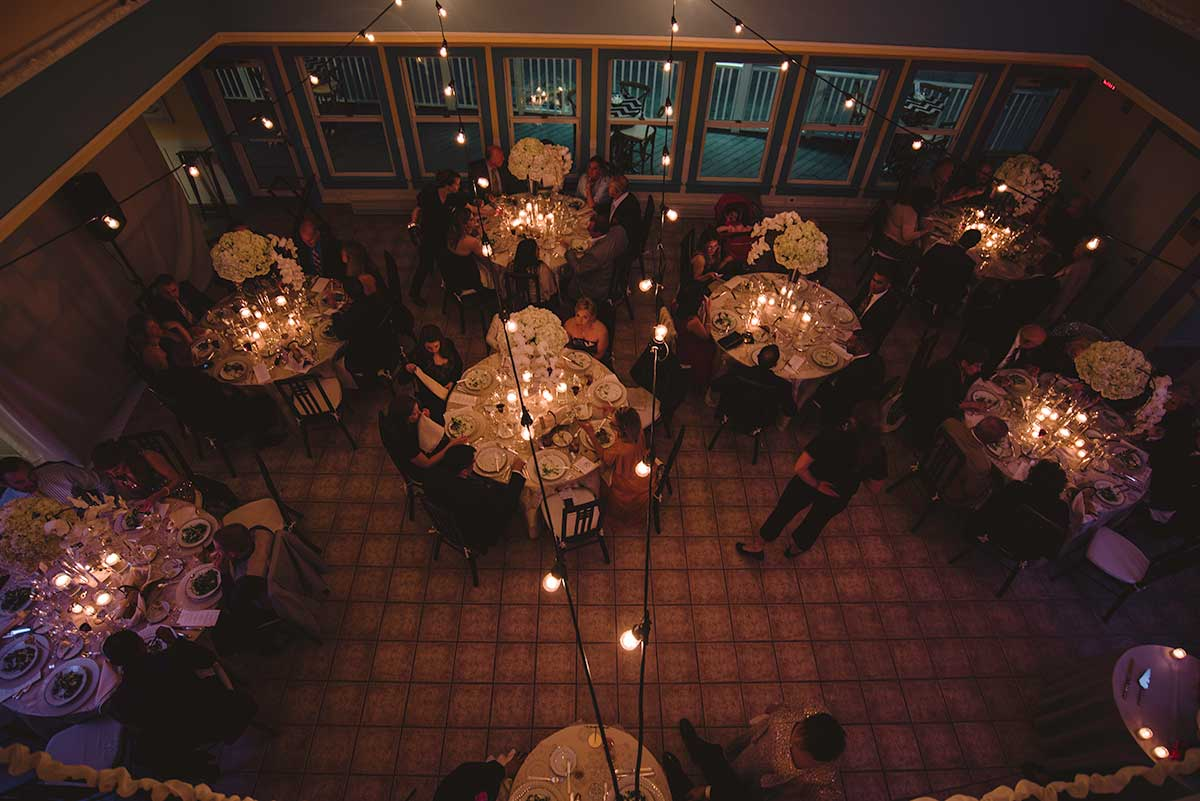 Beach wedding venue. Evening dining room from above.